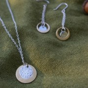 antique bronze satellite orbits a sterling silver moon handcrafted by allie b